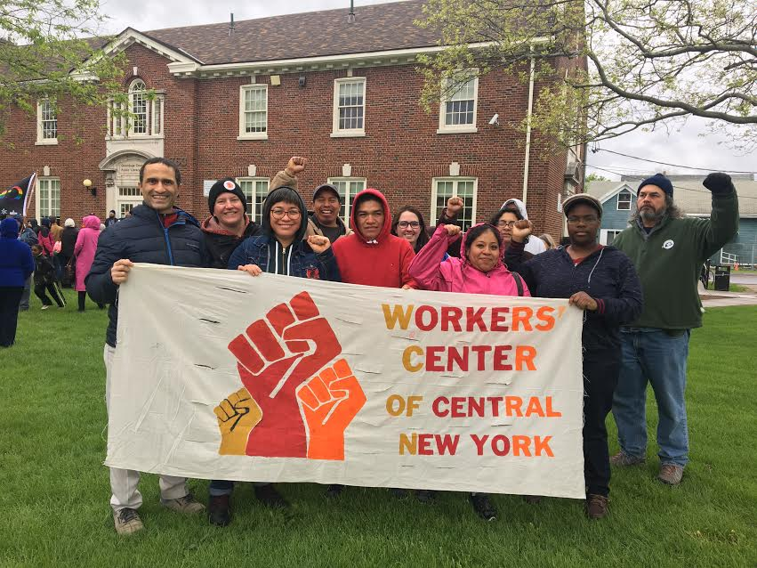 volunteers with Workers Center sign