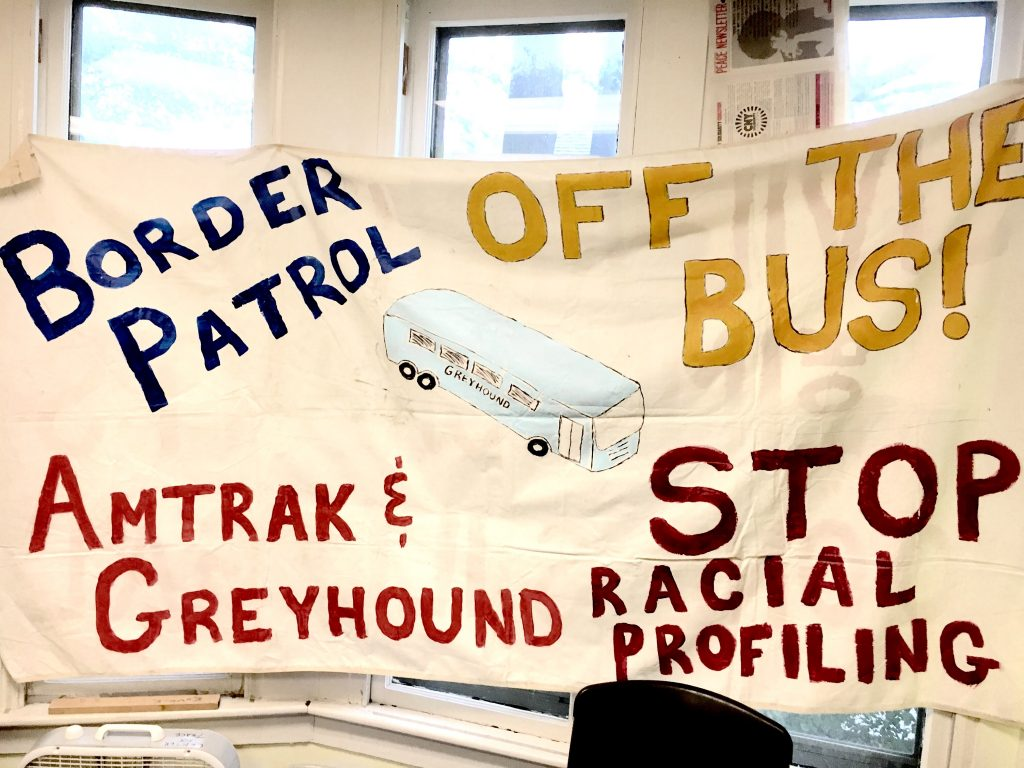 Sign: Border Patrol Off the Bus, Stop Racial Profiling